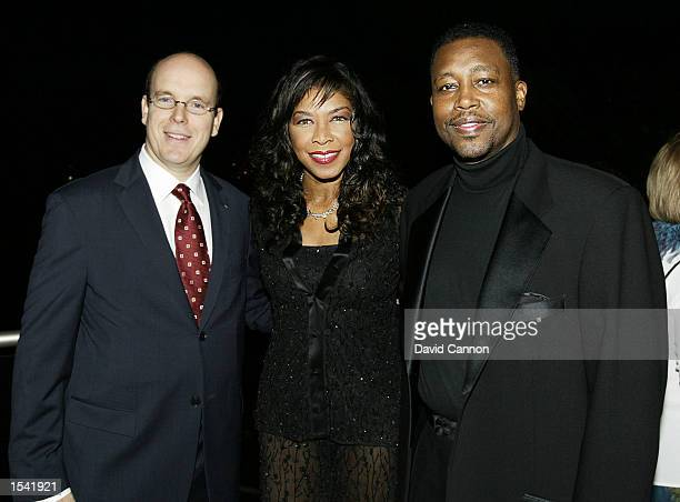 Prince Albert of Monaco Natalie Cole and Kenneth Dupree attend the Laureus Sport for Good Foundation Dinner May 13 2002 at the Salles des Etoiles in...