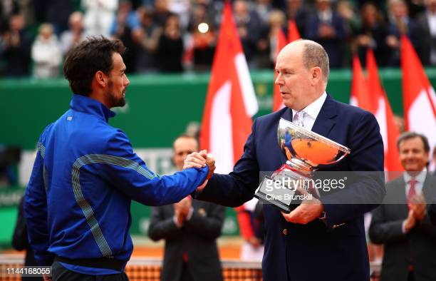 Prince Albert of Monaco presents Fabio Fognini of Italy the winners trophy after his straight sets victory against Dusan Lajovic of Serbia in the...