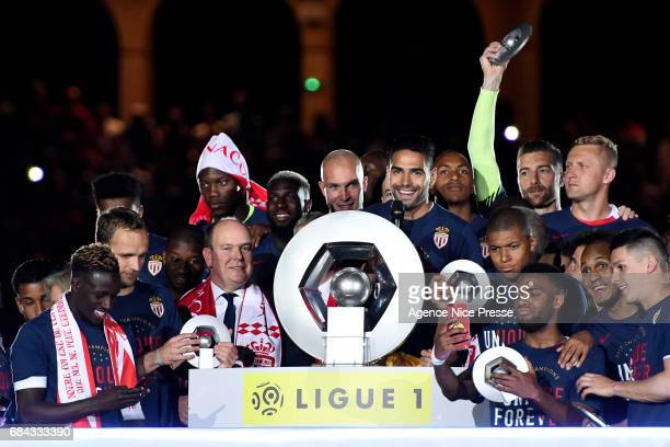 Prince Albert of Monaco Radamel Falcao lift the trophy and players of Monaco celebrate winning the Ligue 1 title after the Ligue 1 match between As...