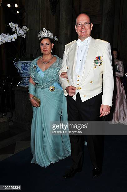 Prince Albert of Monaco sits next to Duchess Maria Teresa of Luxembourg during the Wedding Banquet for Crown Princess Victoria of Sweden and her...