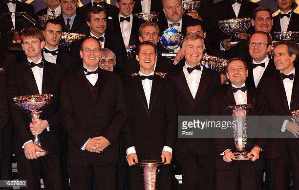 Prince Albert of Monaco stands with World Rally Champion Marcus Gronholm of Finland German Formula One driver Michael Schumacher FIA president Max...