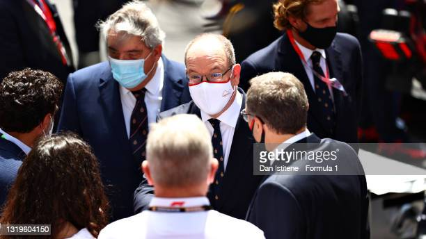 Prince Albert of Monaco talks with Stefano Domenicali, CEO of the Formula One Group, on the grid during the F1 Grand Prix of Monaco at Circuit de...