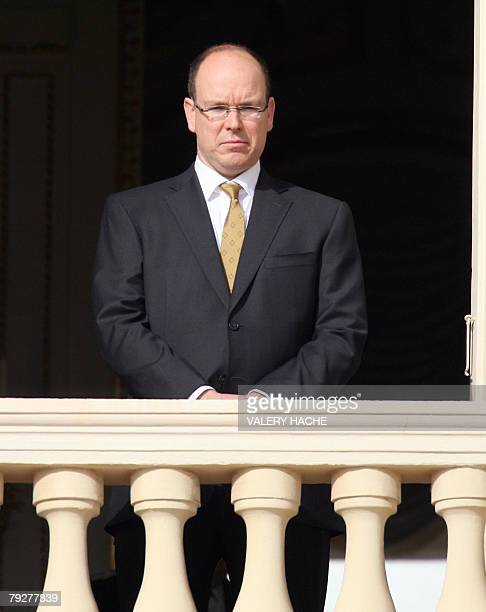 Prince Albert of Monaco watches from the balcony of the Monaco palace the SaintDevote festivities 27 January 2008 AFP PHOTO VALERY HACHE