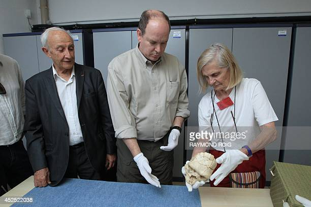 Prince Albert of Monaco with French archeologist geologist and prehistorian Henri Delumley is shown the skull of Tautavel man by the wife of Delumly...