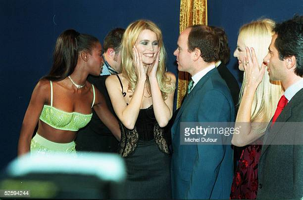 Prince Albert of Monaco with models Naomi Campbell and Claudia Schiffer is seen attending a party in 1996 in Monaco France The Prince's father Prince...