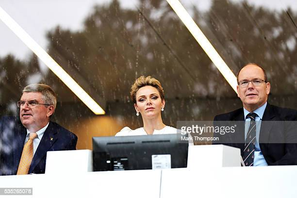 Prince Albert of Monaco with wife Princess Charlene of Monaco and IOC President Thomas Bach watch the action during the Monaco Formula One Grand Prix...