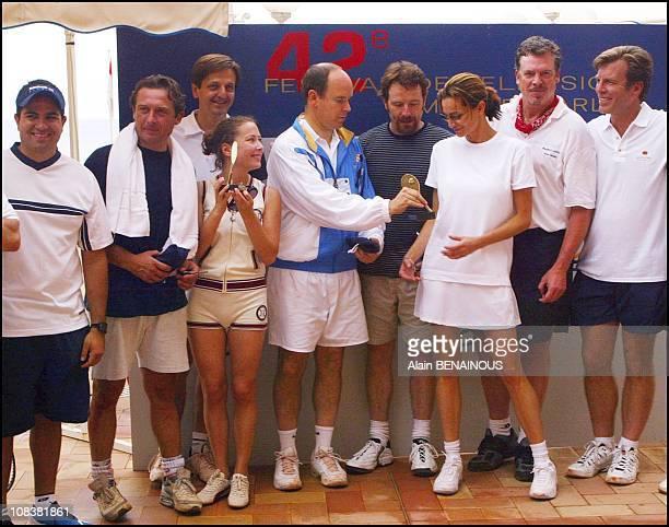Prince Albert offers trophy to his friend Alexandra Kamp in Monaco on July 06, 2002.