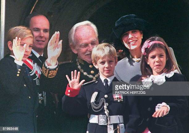 Prince Albert Prince Rainier Princess Caroline and her three children Pierre Andrea and Charlotte wave to their fellow citizens from the royal...