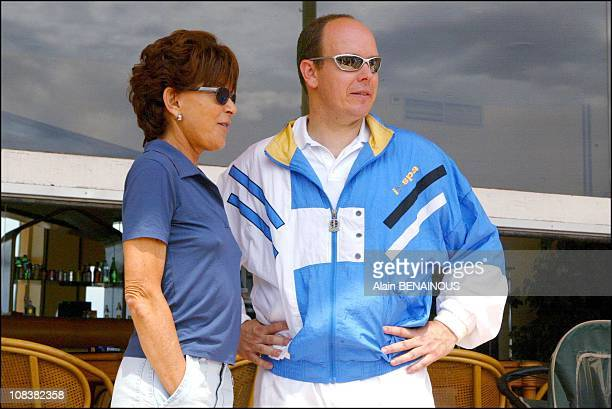 Prince Albert with his cousin Anne de Massy in Monaco on July 06, 2002.
