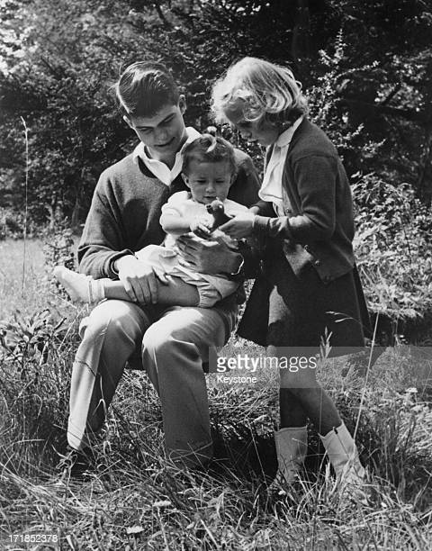 Prince Alexander of Belgium and Princess MarieChristine of Belgium play with their baby sister Princess MarieEsmeralda of Belgium in the grounds of...