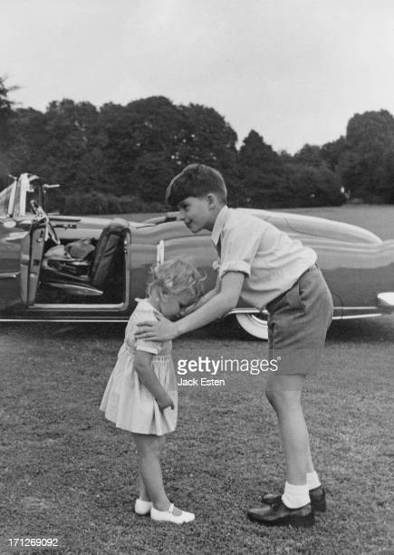 Prince Alexander of Belgium tries to get his sister Princess MarieChristine of Belgium into the correct pose for a picture in the grounds of the...