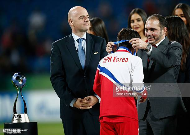 Prince Ali bin Hussein of Jordan and FIFA President Gianni Infantino hand the medal over to captain Pak Hye Gyong of Korea DPR after Korea DPR win...