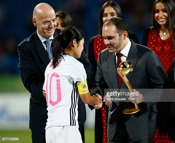 Prince Ali bin Hussein of Jordan and FIFA President Gianni Infantino hand the Golden Adidas Player of the Tournament Trophy over to Fuka Nagano of...