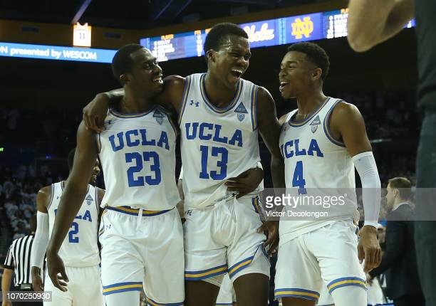 Prince Ali Kris Wilkes and Jaylen Hands of the UCLA Bruins celebrate as they walk off the court after their 6562 win against the Notre Dame Fighting...