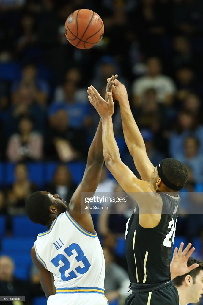 Prince Ali #23 of the UCLA Bruins and George King #24 of the Colorado Buffaloes jump for the ball in the first half of the Colorado v UCLA game at Pauley Pavilion on January 13, 2018 in Los Angeles, California.