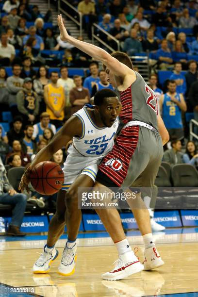 Prince Ali of the UCLA Bruins drives around Riley Battin of the Utah Utes during the second half of a basketball game at Pauley Pavilion on February...