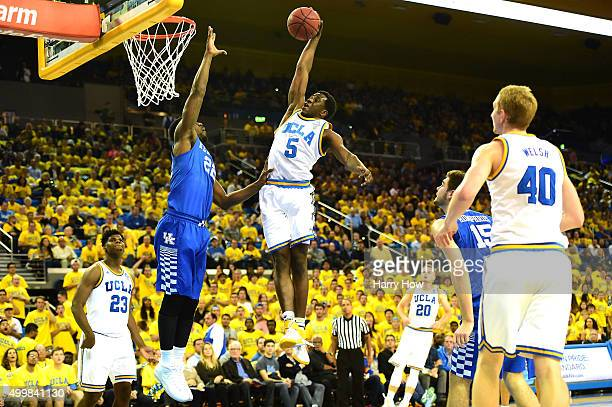 Prince Ali of the UCLA Bruins dunks over Alex Poythress of the Kentucky Wildcats during an 87-77 UCLA win at Pauley Pavilion on December 3, 2015 in...