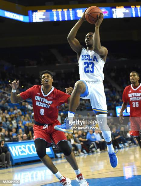 Prince Ali of the UCLA Bruins gets by Kameron Chatman of the Detroit Mercy Titans for a basket in the second half of the game at Pauley Pavilion on...