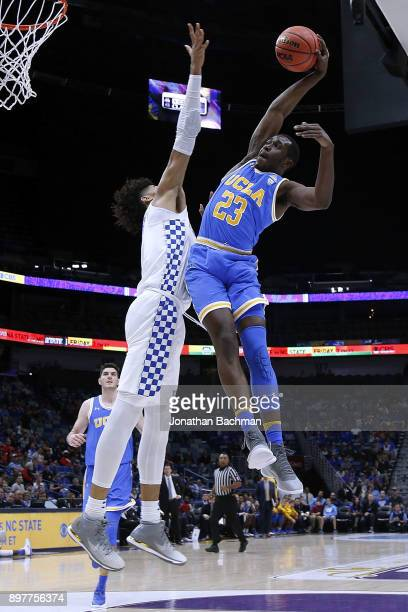 Prince Ali of the UCLA Bruins goes to the basket against Nick Richards of the Kentucky Wildcats during the first half of the CBS Sports Classic at...