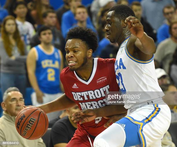 Prince Ali of the UCLA Bruins guards Corey Allen of the Detroit Mercy Titans in the first half of the game at Pauley Pavilion on December 3 2017 in...