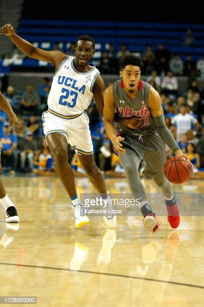 Prince Ali of the UCLA Bruins tries to block Sedrick Barefield of the Utah Utes during the first half of a game at Pauley Pavilion on February 09...