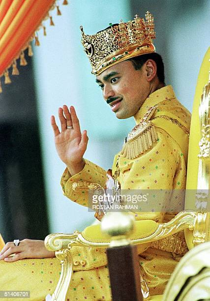 Prince AlMuhtadee Billah 24 yearold heir to the throne of Brunei waves to the crowd during a procession in the town of Bandar Seri Begawan after a...