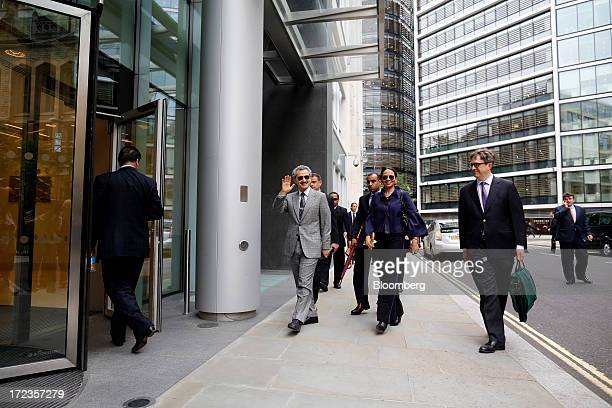 Prince Alwaleed Bin Talal Saudi billionaire and founder of Kingdom Holding Co center waves as he arrives to give evidence at the High Court in London...