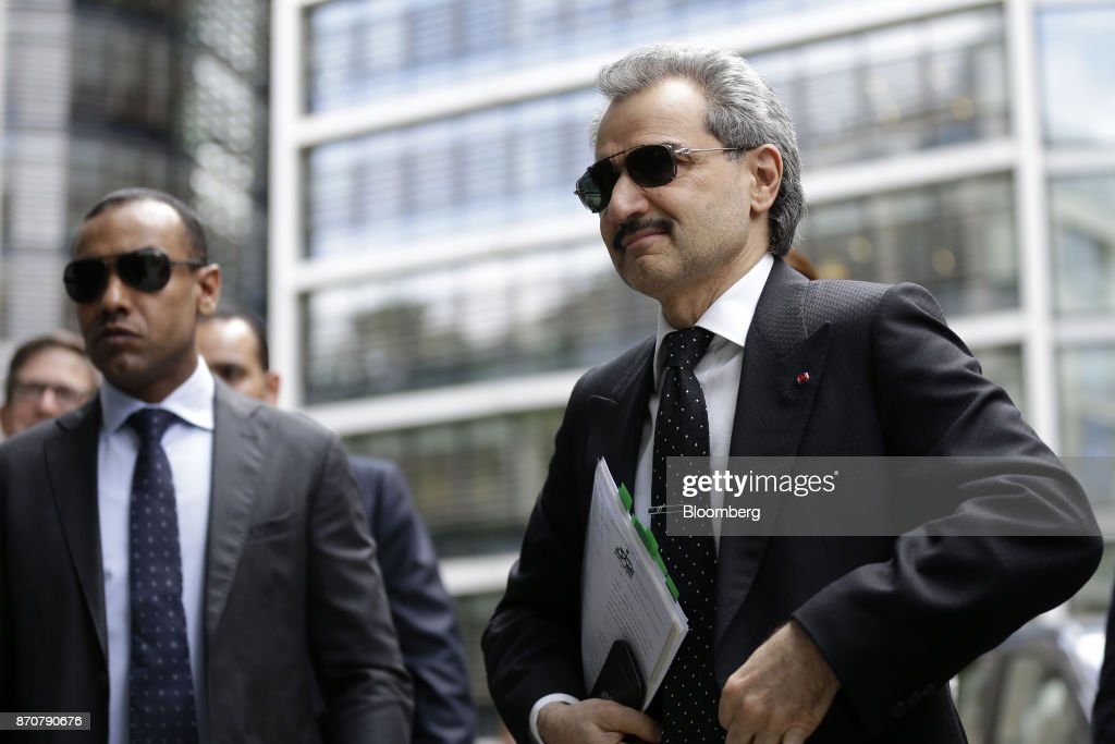 Prince Alwaleed Bin Talal, Saudi billionaire and founder of Kingdom Holding Co., right, arrives to give evidence at the High Court in London, U.K., on Monday, July 1, 2013. Saudi Arabias King Salman embarked on the most sweeping crackdown yet of his reign, ordering security forces to arrest senior princes including one of the worlds richest men and driving out one of the most prominent officials from his ministerial role. Those detained included billionaire Prince Alwaleed bin Talal, who was picked up at his desert camp outside Riyadh, according to a senior Saudi official. Our editors select the best archive images of Prince Alwaleed bin Talal. Photographer: Matthew Lloyd/Bloomberg via Getty Images