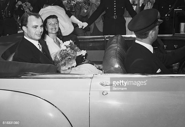 Prince Aly Khan and his bride actress Rita Hayworth leave the Vallauris Town Hall after their double ring wedding ceremonyMay 27th A reception as...