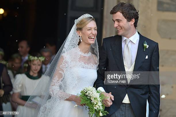 Prince Amedeo of Belgium and bride Elisabetta Rosboch von Wolkenstein celebrate as they leave the basilica Santa Maria in Trastevere after they just...