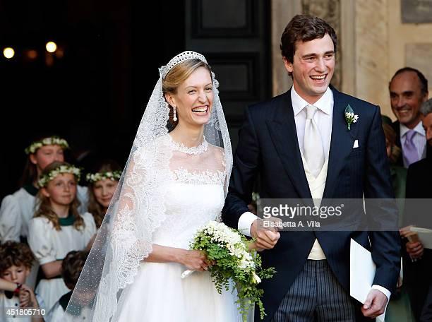 Prince Amedeo of Belgium and Elisabetta Maria Rosboch von Wolkenstein celebrate after their wedding ceremony at Basilica Santa Maria in Trastevere on...