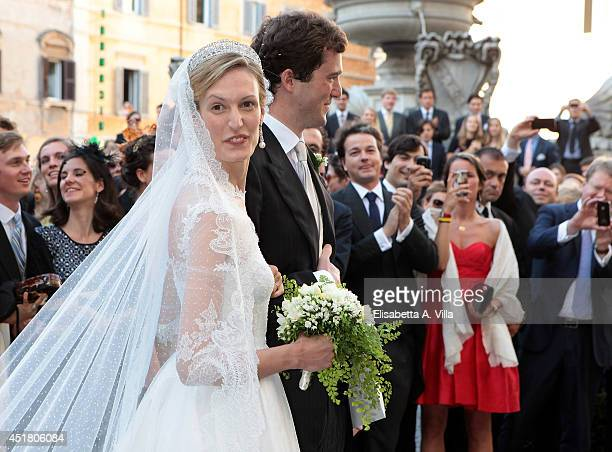 Prince Amedeo of Belgium and Elisabetta Maria Rosboch von Wolkenstein celebrate after their wedding ceremony at Basilica Santa Maria in Trastevere on...