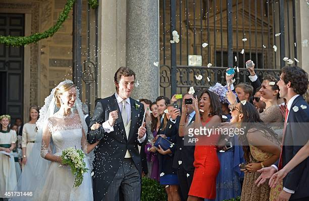 Prince Amedeo of Belgium and Elisabetta Rosboch von Wolkenstein celebrate as the leave the basilica Santa Maria in Trastevere after they just got...