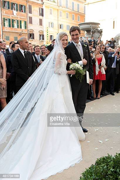 Prince Amedeo of Belgium and his bride Princess Elisabetta Maria celebrate after their wedding ceremony at Basilica Santa Maria in Trastevere on July...
