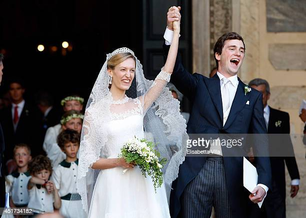 Prince Amedeo of Belgium and Princess Elisabetta Maria celebrate after their wedding ceremony at Basilica Santa Maria in Trastevere on July 5, 2014...