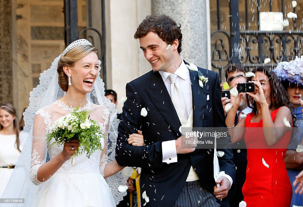 Prince Amedeo of Belgium and Princess Elisabetta Maria Rosboch von Wolkenstein celebrate after their wedding ceremony at Basilica Santa Maria in Trastevere on July 5, 2014 in Rome, Italy.