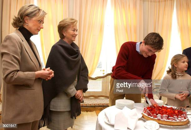 Prince Amedeo of Belgium cuts his birthday cake in the presence of Queen Paola Princess Astrid and Princess LouisaMaria during a photocall to...