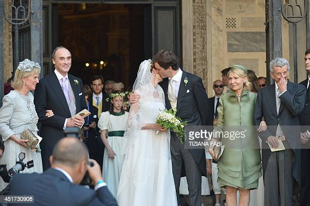 Prince Amedeo of Belgium kisses the bride Elisabetta Rosboch von Wolkenstein as they leave the basilica Santa Maria in Trastevere after they just got...