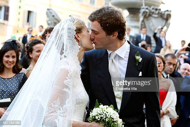 Prince Amedeo of Belgium kisses the bride Princess Elisabetta Maria after their wedding ceremony at Basilica Santa Maria in Trastevere on July 5 2014...