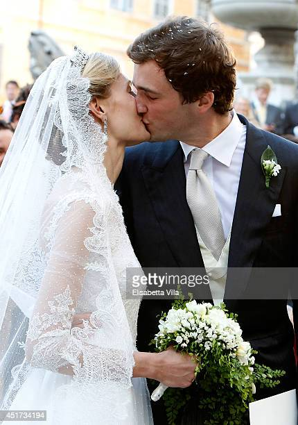 Prince Amedeo of Belgium kisses the bride Princess Elisabetta Maria after their wedding ceremony at Basilica Santa Maria in Trastevere on July 5,...