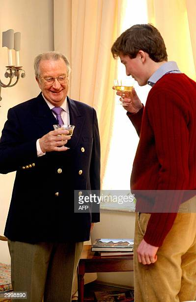 \Prince Amedeo toasts with his grandfather King Albert II of Belgium as he celebrates his 18th birthday 20 February 2004, in Brussels. AFP PHOTO...
