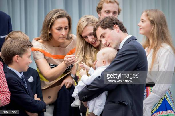 Prince Amedeo with his daughter Anna Astrid and his wife Lili Princess Claire Prince Aymeric and Prince Nicolas of Belgium attend the 80th birthday...