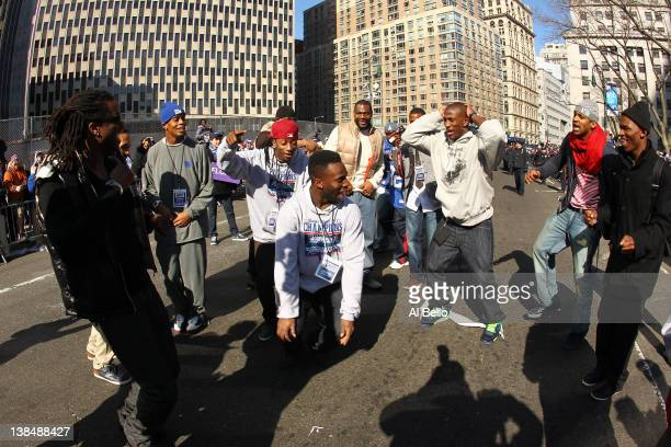 Prince Amukamara and Antrel Rolle of the New York Giants dance with their teammates during the New York Giants ticker tape victory parade down the...