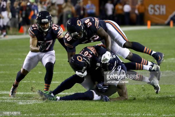 Prince Amukamara of the Chicago Bears tackles Brandon Marshall of the Seattle Seahawks in the first half at Soldier Field on September 17 2018 in...