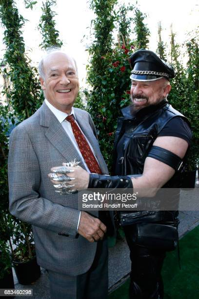 Prince Amyn Aga Khan and Peter Marino attend the 'The Garden of Peter Marino' Book Signing at 'Moulie Flowers' on May 15 2017 in Paris France Preface...