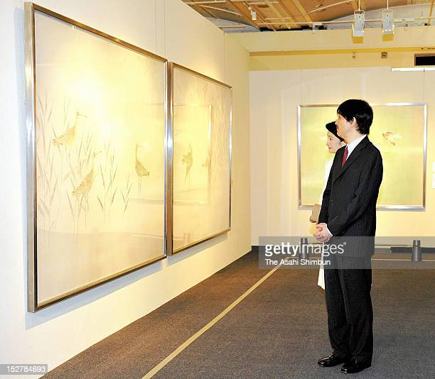 Prince and Princess Akishino watch traditional Japanese paintings by Atsushi Uemura nihonga artist on September 25 2012 in Tokyo Japan