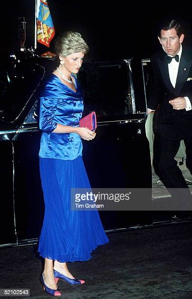 Prince And Princess Of Wales Arriving By Official Car At The Sydney Opera House Australia Princess Diana Is Wearing A Blue Satin Bodice And Skirt...