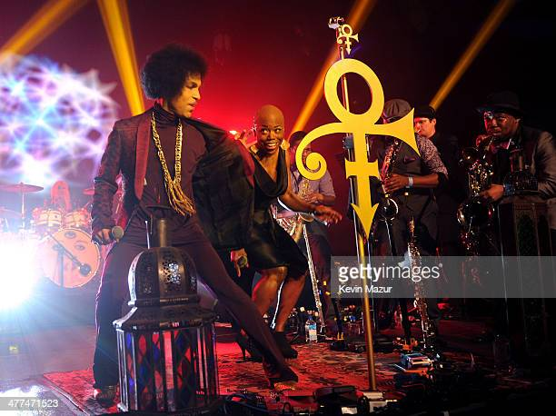 Prince and Shelby J perform onstage at The Hollywood Palladium on March 8 2014 in Los Angeles California