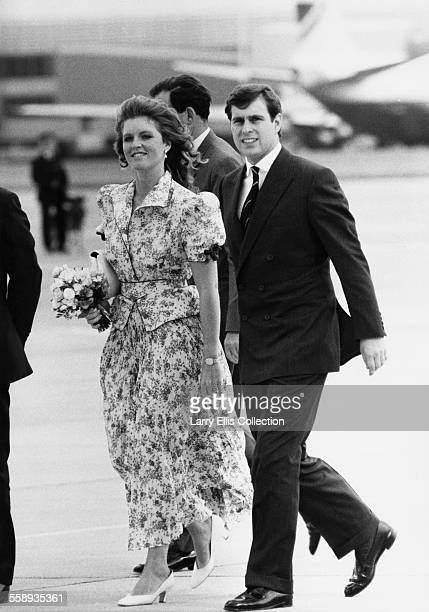 Prince Andrew and his wife Sarah at Heathrow Airport as they leave for their honeymoon 23rd July 1986