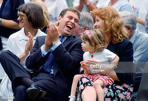 Prince Andrew And Sarah Duchess Of York Sit Laughing With Princess Eugenie On Her Lap They Are Attending The School's Sports Day